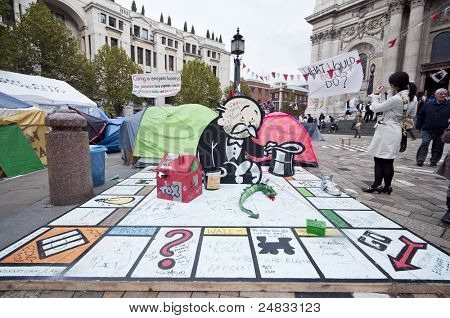 LONDON, UK -OCTOBER 31: Occupy London outside St.Paul's Cathedral with Banksy's donation to protesters on October 31, 2011 in London.