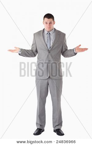 Portrait of a lost businessman against a white background