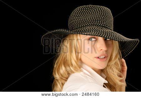 Glamour Model Wearing High Fashion Hat Looking Sideways