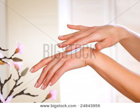 Healthy Hands.Female applying moisturizer to her Hands after bath.Skincare concept