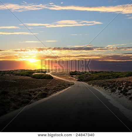 Asphalt road in countryside and cloudy sky