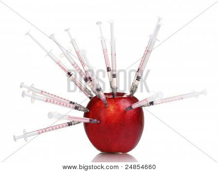 red apple and syringes isolated on white