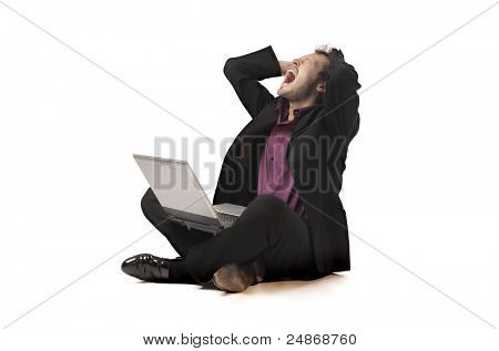 Screaming businessman using a laptop