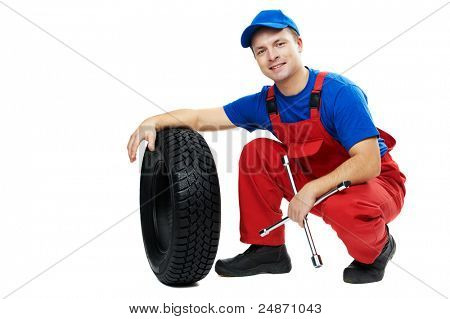 serviceman repairman automobile mechanic with car tire and spanner wrench isolated
