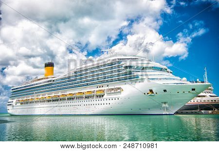poster of Cruise Ship At Sea Dock In Turquoise Sea. Travelling By Sea On Cruise Ship. Water Transport Of Cruis