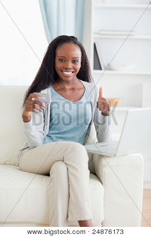 Smiling woman satisfied with online shopping