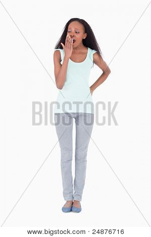 Tired young woman on white background