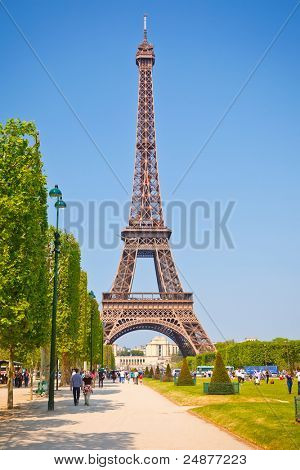 PARIS - APRIL 25: Tourists enjoy sunny day near  Eiffel Tower on April 25, 2011 in Paris, France. Eiffel Tower  stands 324 meters tall and is the tallest building in Paris.