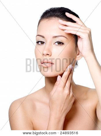Woman Stroking Her Face