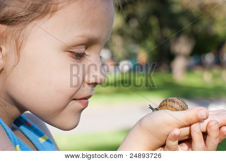 a child with a snail
