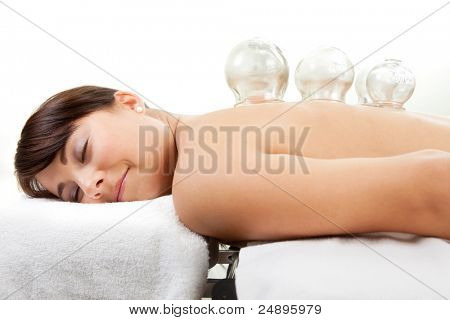 Female laying on chest with cupping treatment on back