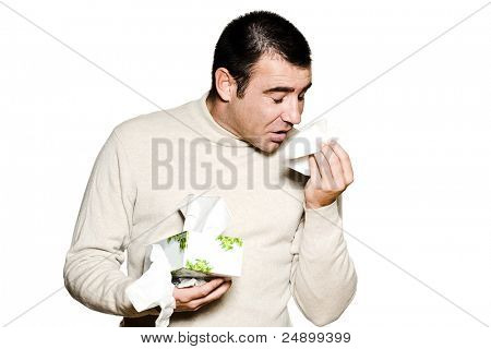 Portrait of a caucasian  man sneezing cold and flu allergy in studio isolated on white isolated background
