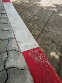 Footpath Road. Red And White Concrete Sidewalk Curb With Brick poster