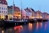 stock photo of copenhagen  - scenic evening panorama of nyhavn in copenhagen - JPG