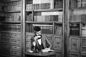 Mature Man Near Old Bookcase. Education, Work, Leisure, Coffee Break, Classic Style Concept. Editor  poster