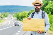 Man Bearded Hitchhiker Stand At Edge Of Road With Blank Paper Sign, Copy Space. Benefits Using Sign  poster