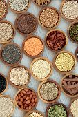Dried macrobiotic super food  with legumes, seeds, nuts, cereal, grains, vegetables & whole wheat pa poster