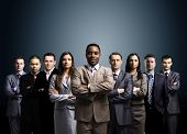 pic of crew cut  - business team formed of young businessmen standing over a dark background - JPG