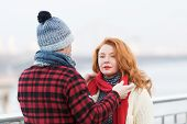 Rude Women With Red Woolen Scarf And Guy In Red Jacket. Man Dressing Red Scarf On Woman. Rouge Woman poster