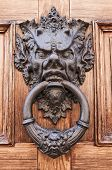 stock photo of ferrara  - Close up of a doorknocker in Ferrara city - JPG