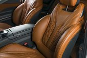 Modern Luxury Car Inside. Interior Of Prestige Modern Car. Comfortable Leather Red Seats. Brown Perf poster