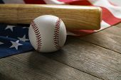 Baseball And Baseball Bat With American Flag On The Wooden Table poster