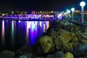 Beautiful Evening With Cafes And Restaurants , Waves And Surf In The Evening Twilight, In Bay Crete, poster