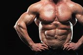 Close-up - Male Fitness Model With Naked Torso Showing Sixpack Abdominal And Muscular Body. poster