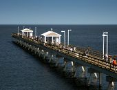 image of fisherwomen  - a fishing pier with people fishing and crabbing - JPG