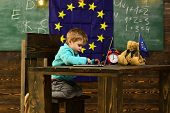 New Technology. Little Child Use Laptop Computer In Classroom With Eu Flag, New Technology. New Tech poster