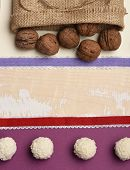 Natural Sweets, Paper Sheets And Ribbons, Copy Space. Healthy Sweets On Light Wooden Texture Backgro poster