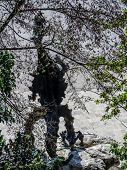 Silhouette of a statue of legendary Wawel Dragon situated at the foot of Wawel hill, Krakow, Poland  poster
