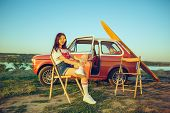 Woman And Happy Trip By Car. Laughing Girl Sitting In The Car While Out On A Road Trip Near River. S poster