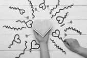 Female Hand Holding Handmade Wooden Heart. Red Fuzzy Wire Hearts And Tiny Pegs On White Vintage Back poster