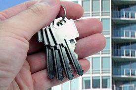 image of real-estate agent  - real estate agent hands over the keys - JPG