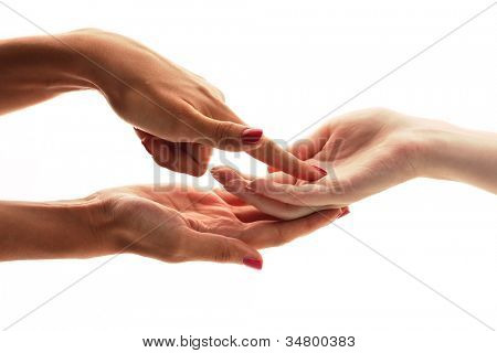reading the lines hand in a woman's hands isolated on white