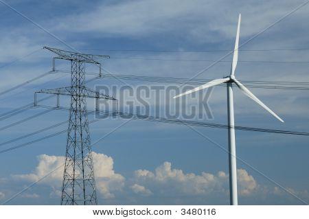 Windturbine Close To A Electric Pylon