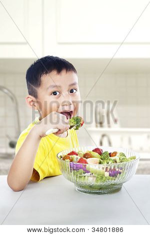 Asian Child Eating Salad