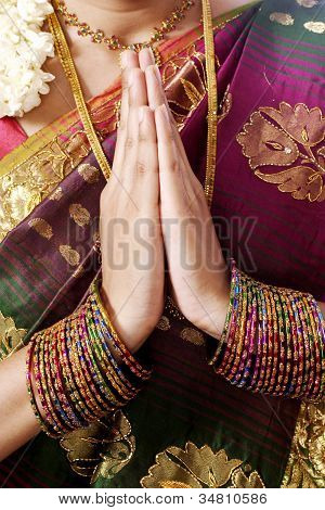 Woman Holding Hands In Prayer Position