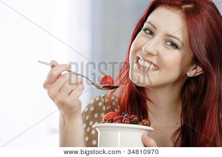 Happy Woman Enjoying Fresh Fruit