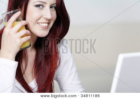 Happy Smiling Woman At Home On Laptop