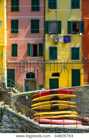 Old houses in Riomaggiore with canoes, Cinque Terre, Italy
