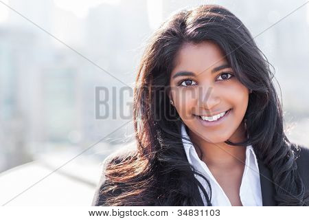 A shot of a smiling confident Asian Indian businesswoman outdoor