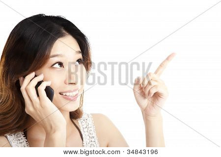 young woman talking on the phone and pointing something