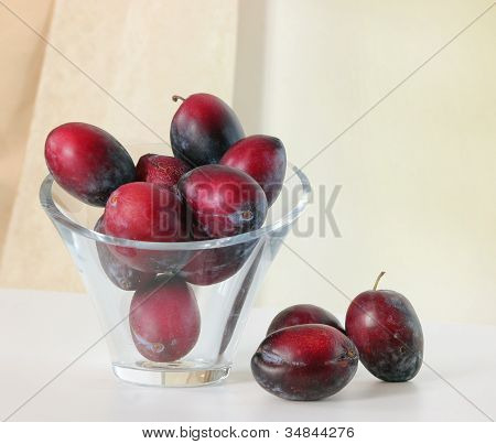 Natural Plums in Glass Vase
