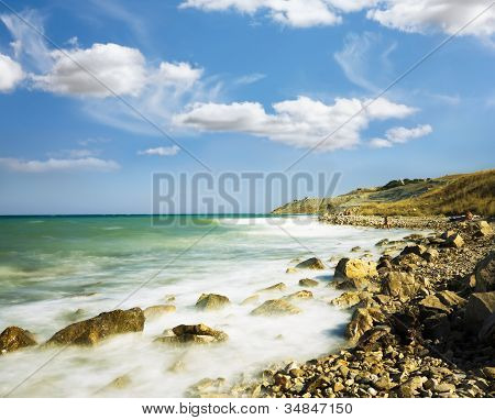 Sea Sky Stones.wave Winding Coastline Accrue At.