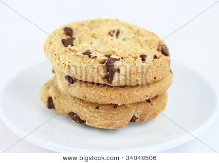 Chocolate chip cookies Close up group on a white plate isolated on white