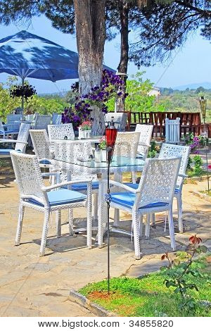 Cafe On The Open Air With White Furniture