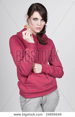 Girl In Hooded Top With Lollipop