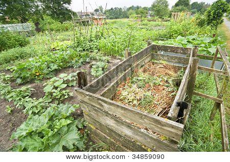 Compost bin in a vegetable garden